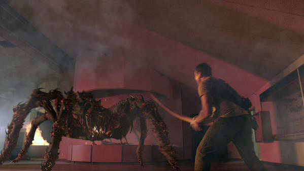 Caption- Colton fights a lava tarantula inside the museum. Credit- Lavalantula Syfy 2015